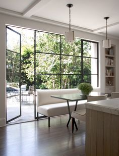 Acordian windows and doors kitchen transitional with exposed beams ceiling…
