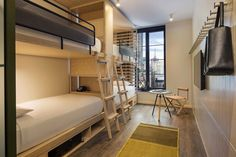 """The bunk rooms exhibit the same attention to detail. """"There's a huge benefit to bringing luxury hotel designers like Yabu Pushelberg to an affordable hotel project,"""" says Hochberg. """"It's not just about creating an efficient space that looks good. Bunk Rooms, Bunk Beds, Bedrooms, Rockwell Group, Pebble Floor, Yabu Pushelberg, Chelsea Hotel, Affordable Hotels, Private Dining Room"""