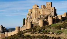 CASTLES OF SPAIN - Castle of Loarre, Huesca. One of the best-preserved Romanesque fortresses in Spain, Loarre's eight towers were once used to defend the royal palace against Muslim invaders. Built on a rocky escarpment with panoramic (and strategic) views over the surrounding countryside, it was located on the borders of Muslim and Christian influence in what is now Huesca.