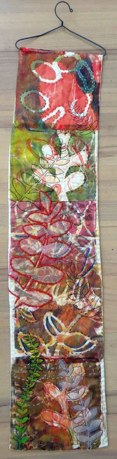 Jane LaFazio - Rain Forest ~ an original wall hanging  we could use our little fabric swatch hooks to hold our prayer flags/fabric bunting