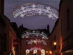 Star banners twinkle and shine for a #festive touch. #holiday #lights #commercialdecor