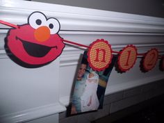 Elmo First Year tag banner is a perfect idea to display pictures of child's first year....great idea!