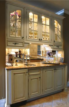 I like the lit cabinets and extra sink. I also like how it is open to kitchen.