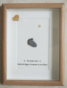 This is a beautiful small Pebble Art framed Picture of a Baby Foot - The littlest Feet make the biggest Footprint on our Hearts handmade by myself using Pebbles, Driftwood, White & Wooden Heart Size of Picture incl Frame : approx. 22cm x 17cm This Picture is finished and only available as shown in Photo Thanks for looking Doris Facebook: https://facebook.com/Pebbleartbyjewlls4u Product Code: P - Red