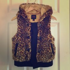 Forever 21 cheetah print faux fur vest Very comfy and nice feeling, in great condition. Front tassels removed. Snap buttons up and has pockets. All items negotiable, ask for additional info or photos and I'll get back to you right away! Forever 21 Tops