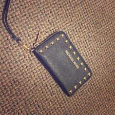 Michael Kors Wristlet Black Michael Kors Wristlet with gold studs. Used but in great condition! Michael Kors Bags Wallets