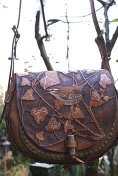 My kingdom for a SkyRavenWolf bag!!  elaborately carved boho style bag with wrens and ivy leaves
