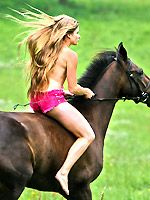 Sign up now - Sexy Julia rides on her horse at ridingfantasy.com/main.htm