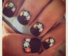 """Today's nails are from Lina C and she has these beautiful black matte nails with a flower print on top! Love them! For more Nail Art inspiration, or to chat with us about your favorites, check out our Nail Art space onMightyBell.com! HelloGiggles loves seeing your creative nail designs. From glitter and lace to cartoon and holiday homages, we appreciate a bomb manicure when we see it. Please send a photo of your fancy fingertips toinfo@hellogiggles.comwith the subject line """"Nails of the…"""