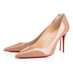 """""""Decollete 554"""" stands out for her long pointed toe and superfine stiletto heel. Whether you're dashing to a daytime meeting or an evening date, this 85mm version in classic nude patent leather is a refined look for the woman on the move."""