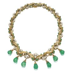 EMERALD AND DIAMOND NECKLACE, CARTIER, 1950S Composed of a line of stylised gold leaves, accented with cabochon emeralds and brilliant-cut d...