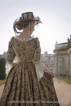 Trevillion Images - historical-woman-in-grounds-of-country-house