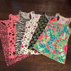 Set of 6 junior racer back tank tops Pink leopard, pink with black stars, zebra, a white peace heart and stars, a navy peace sign and a lime green and hot pink tie-dye. The only stains I see are shown on the pictures and that is on the peace and heart tank and the zebra tank. No Boundaries Tops Tank Tops