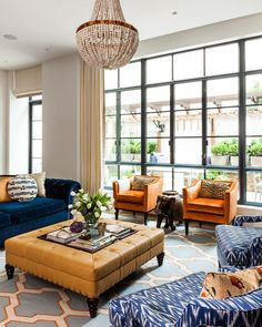 A bold living room with patterned furniture and a crystal chandelier