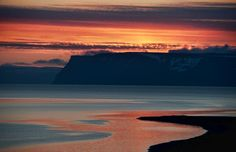 Orange sky above calm seas. Photo by Trey Ratcliff.