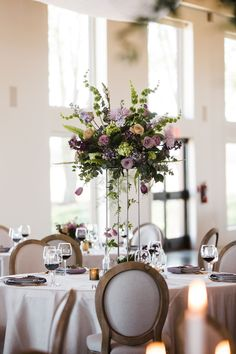 Beautiful mix of spring blooms in purple lavender and pink with bells of Ireland & mini green hydrangeas placed on top of Harlow stand for this April wedding. Pink Hydrangea Centerpieces, Tall Wedding Centerpieces, Wedding Table Flowers, Wedding Arrangements, Wedding Colors, Floral Arrangements, Table Arrangements, Wedding Themes, Pink Green Wedding