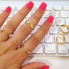 pink nails, short and square. Gold rings