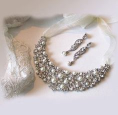 A personal favorite from my Etsy shop https://www.etsy.com/listing/100764257/bridal-jewelry-set-bridal-bib-necklace