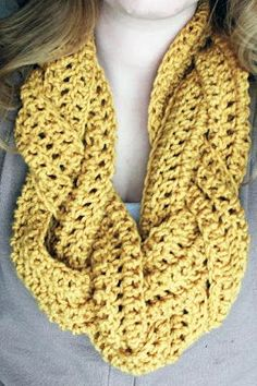 Braided Scarf- 60 or so chain stitches (depends on your desired length) Double crochet back onto the chain Repeat for a total of five rows of double crochets(not including chain) x3 Take your three mini scarves and braid them together.Then sew your ends to make it an infinity and youre all set!