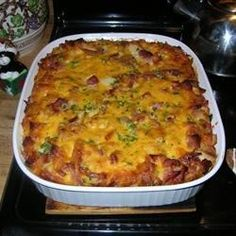 A hearty ham and cheese breakfast casserole with a crispy cornflakes topping. But skip the cornflake topping.