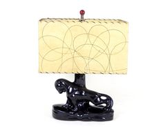Hey, I found this really awesome Etsy listing at https://www.etsy.com/listing/201782635/mid-century-modern-kitsch-panther-lamp