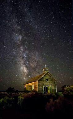 The Milky Way over historic St. Bridget's church in Oregon