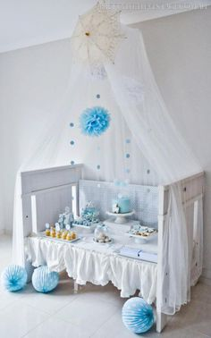 Showered-from-above-Shower-Baby-Shower-by-Justine-via-babyshowerideas4u.com-adorable-crib-as-dessert-table