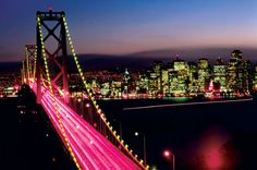 A poster featuring a great night shot of the San Francisco-Oakland Bay Bridge in California. San Francisco City, San Francisco California, San Francisco Wallpaper, San Francisco Pictures, San Francisco Attractions, Places To Travel, Places To Visit, San Fransisco, Around The Worlds