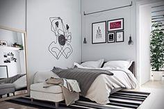 chambre adulte couleur blanche avec un grand lit tabouret et tapis à rayures