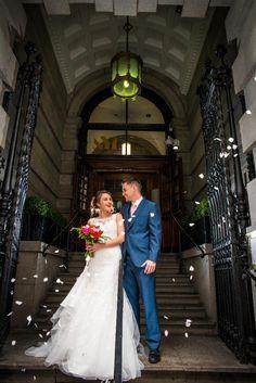 Newlyweds on the doorstep of the Aloft Liverpool; a hotel wedding venue near Liverpool, Merseyside.