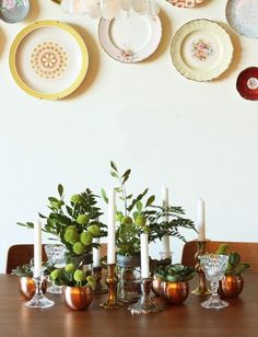 Since I'm a bit of a magpie when it comes to metal and glass (ooh, shiney!), I have loads of mismatched stuff - thus, I like this mixed up table deco.   11 Ways to Use & Display Vintage Metals