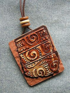 Polymer clay; wooden beads.