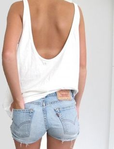 White open back tank top and Levis shorts.
