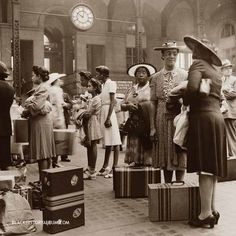 A group of African American women waiting for their trains at the Pennsylvania railroad station, New York City, 1942. Sepia tone (original b/w).
