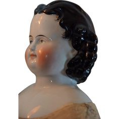 Pretty china doll with a women face. Perfect bisque shoulderhead with a very nice painting. and a little curvy hair near the ears.    The leather kid body in pretty good condition despite her age.