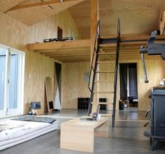 Plywood barn conversion. Live in artist studio. Mezzanine loft. Etsy - About EmpireOfRoam