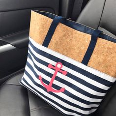 Hit the road and get away with this great everyday tote, featuring a large open interior compartment with one interior zip pocket and two interior flat pockets for all your necessities. The cork detail is so on-trend for summer!