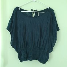 Free People Batwing Blouse Navy blue batwing the top. Key hole in back with three ties. Front and back have different fabric, the back is more patterned and sheer than the front.   Size: XS Brand: Free People Free People Tops Blouses