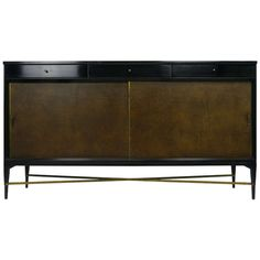 Paul McCobb credenza in Walnut, Leather and Brass | From a unique collection of antique and modern credenzas at http://www.1stdibs.com/furniture/storage-case-pieces/credenzas/