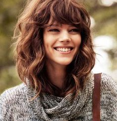 Medium Length Hairstyles for Thick Wavy Hair with Bangs