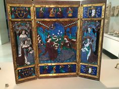 Portable altarpiece, French, showing King Louis XII with St. Louis, and Anne of Brittany with St. Anne, likely on the occasion of their marriage in 1499. Note the arms of France and Brittany. — at Victoria and Albert Museum.