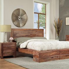great rustic bed - with a big duvet and lots of pillows... Love