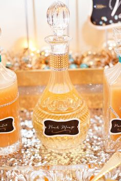 Storing peach mango juice for bellinis in apothecary bottles