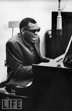 "Ray Charles performs a song at the piano in Los Angeles in 1965. He was born Sept. 23, 1930, and died June 10, 2004. Frank Sinatra once called him ""the only true genius in the business."""