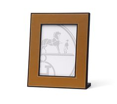 """Pleiade Leather picture frame in gold goatskin with solid rosewood.Measures 5.1"""" x 7.1""""."""