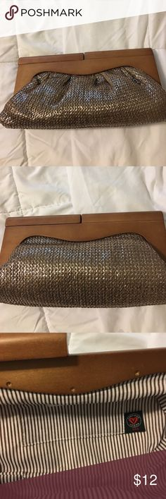Brand New Poppie Jones Clutch Really nice Poppie Clutch that I have never carried, it has a wood closure with striped inside, Outside is a fancy bronze material almost like sequins but not quite. Excellent condition!! Poppie Jones Bags Clutches & Wristlets
