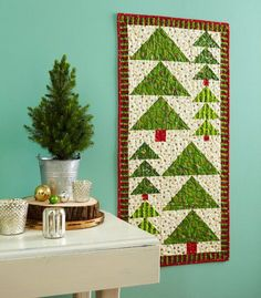 Brighten a wall and accent a winter scene nearby with a forest that truly is  evergreen.