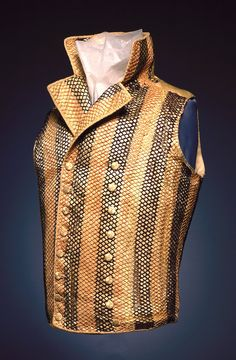 Waistcoat, ca. 1795. Yellow silk, patterned with a knotted net of stripes in brown, peach and cream.