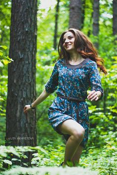 Running with smile - Beautiful girl in the forest