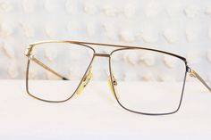 80s Mens Glasses 1980's Aviator Eyeglasses Metal Wire Rim Frame Two Tone Finish 58/13 NOS by Univis Optical. $47.00, via Etsy.